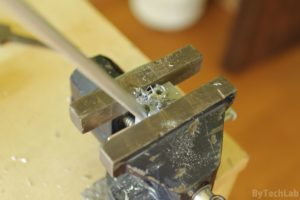Discone antenna - Drilling holes in aluminum rods with help of drill guide and a vice (cone rods)