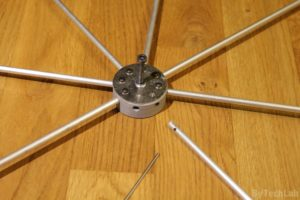 Discone antenna - Top disc assembly - inserting and bolting down aluminium rods 2