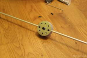 Discone antenna - Top disc assembly - inserting and bolting down aluminium rods